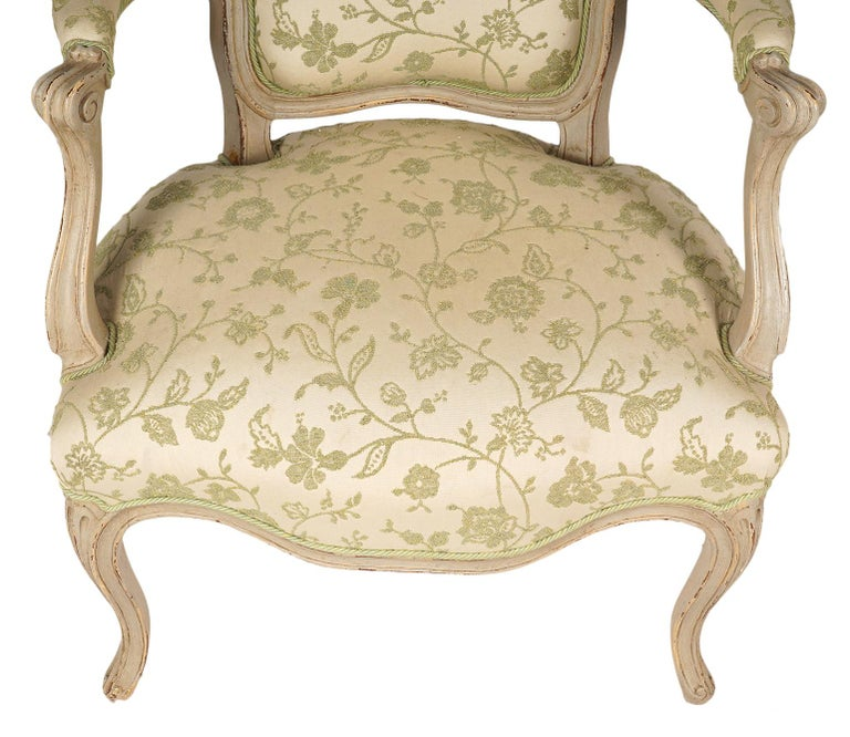 Fabric Pair of French Louis XV Style Carved and Painted Upholstered Armchairs For Sale