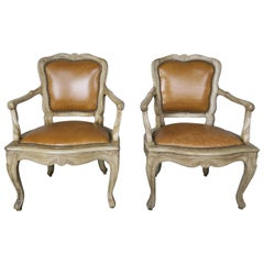 Pair of French Louis XV Style Carved Bleached Walnut and Leather Armchairs