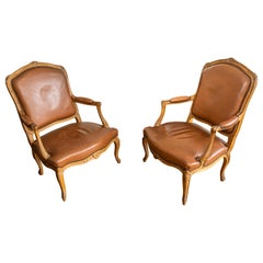 Pair of French Louis XV Style Carved Oakwood and Leather Armchairs