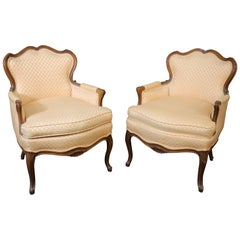 Pair of French Louis XV Style Carved Walnut Bergère Club Chairs, circa 1950