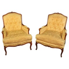 Pair of French Louis XV Style Carved Walnut Bergère Lounge Chairs