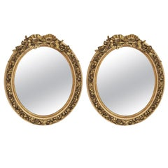 Pair of French Louis XV Style Gilt Oval Mirrors
