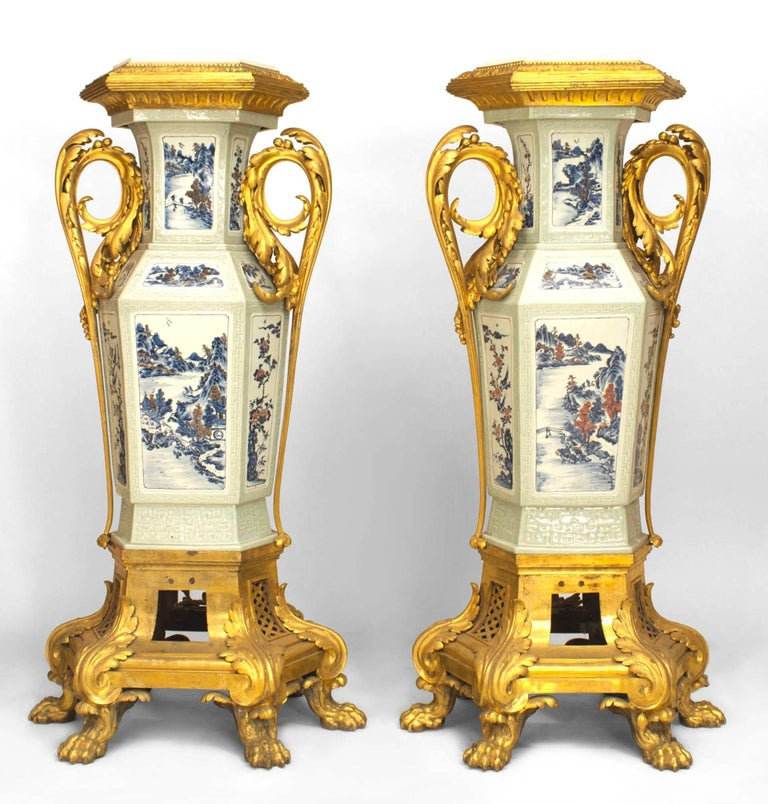 Pair of French Louis XV style (19th century) pedestals with Asian Chinese style celadon porcelain and bronze doré festoon trim and base with claw feet.