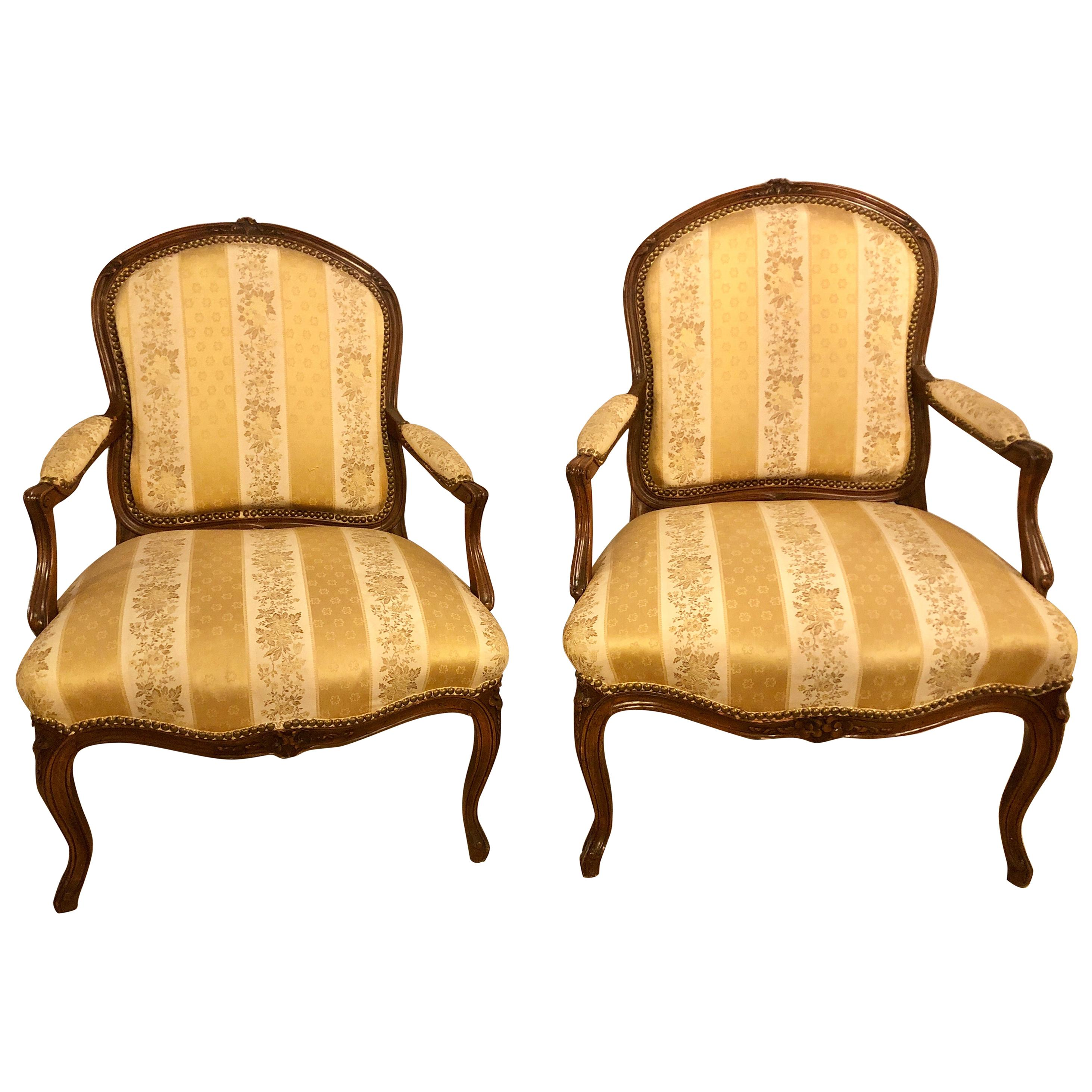 Pair of French Louis XV Style Walnut Arm-Chairs Bergeres in a Fine Upholstery