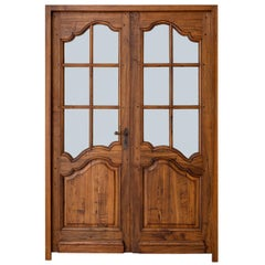 Pair of French Louis XV Style Walnut Entry Doors