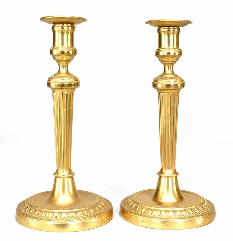 Louis XVI fluted candlesticks, 19th century, offered by Newel