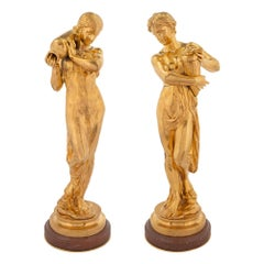Pair of French Louis XVI Style Ormolu and Rouge Griotte Marble Statues