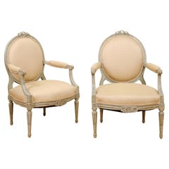 Pair of French Louis XVI Style 1850s Oval Back Armchairs with Carved Ribbons