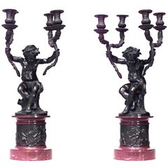 Pair of French Louis XVI Style Cupids Holding Two-Arm Candelabra