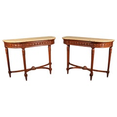 Pair of French Louis XVI Style Carved Walnut Demilune Console Tables