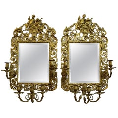Pair of French Louis XVI Style Gilt Bronze and Mirrored Sconces