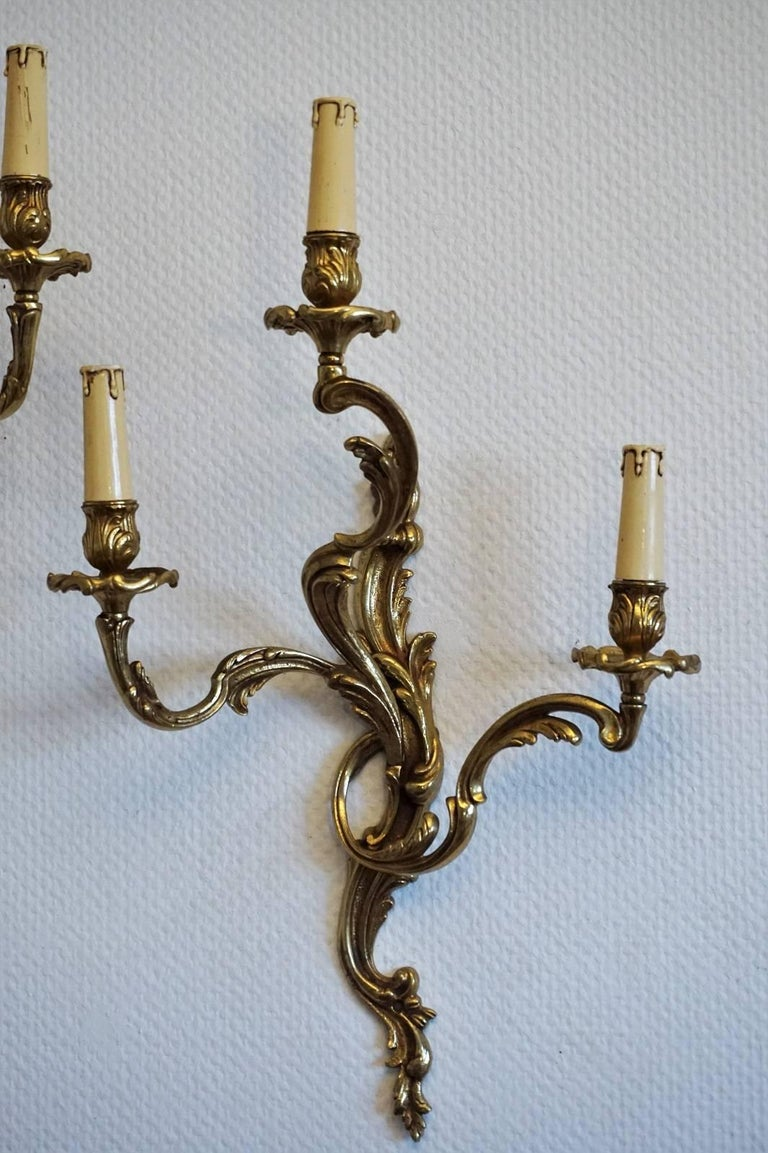 19th Century Pair of French Louis XVI Style Gilt Bronze Electrified Three-Light Wall Sconces For Sale