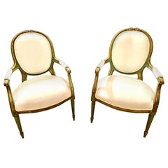 Pair of French Louis XVI Style Green Paint and Gilt Chairs with Bow Decoration