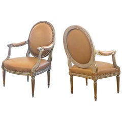 Pair of French Louis XVI Style Grey/Green Painted and Parcel-Gilt Armchairs