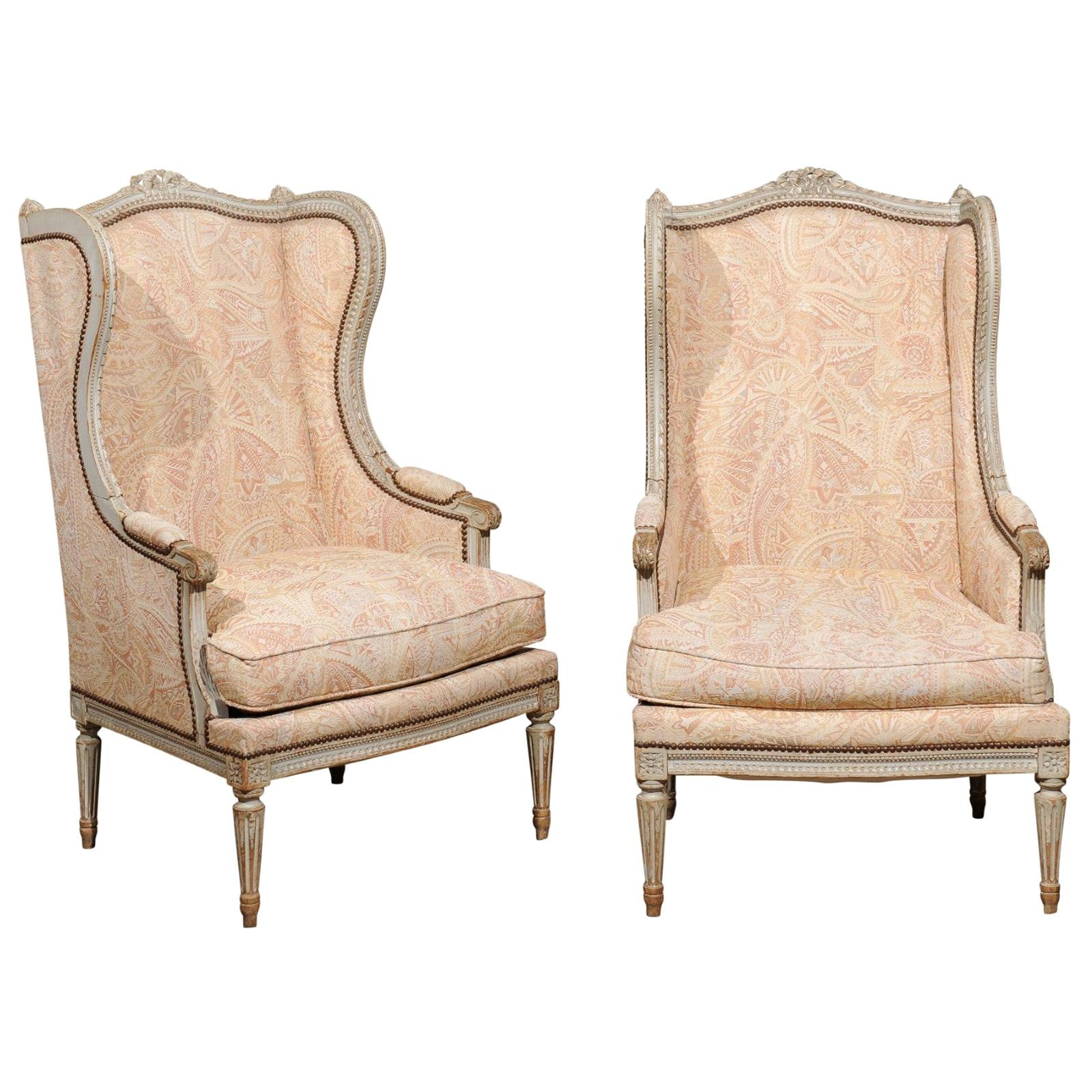 Pair of French Louis XVI Style Painted and Carved Wooden Bergères à Oreilles