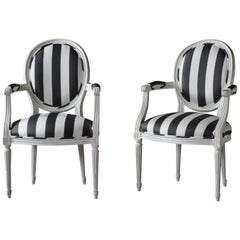 Pair of French Louis XVI Painted Arm Chairs