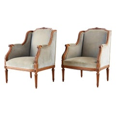 Pair of French Louis XVI Style Walnut Bergère A Oreilles