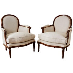 Pair of French Louis XVI Style Walnut Bergeres