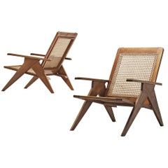 Pair of French Lounge Chairs in Cane and Mahogany