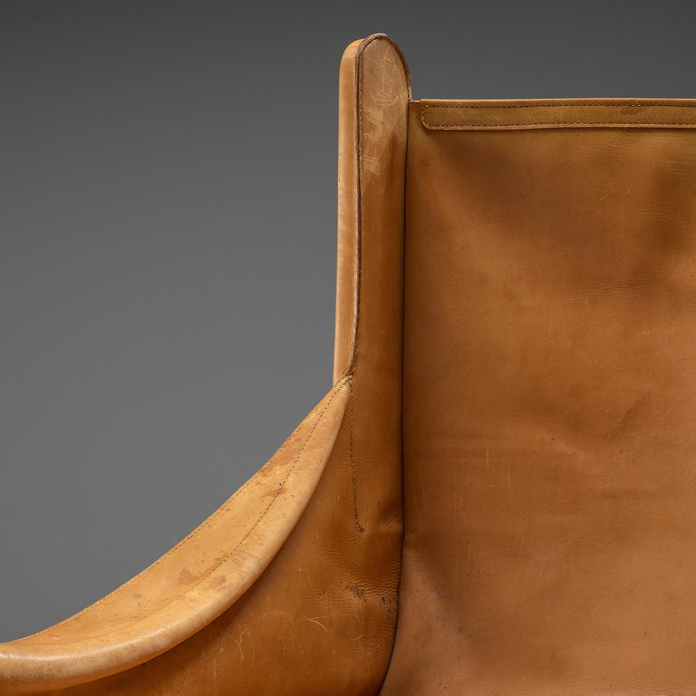 Mid-Century Modern Pair of French Lounge Chairs in Cognac Leather For Sale