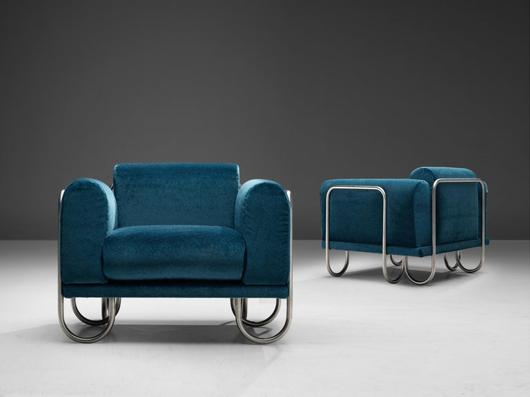 Pair of French club chairs, fabric, metal, France, 1970s  A comfortable easy chair that features a curved, chromed tubular frame. The frame appears to be an ongoing curved line, moving upwards to support the cushions and downwards, functioning as
