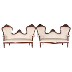 Pair of French Mahogany Framed Spoon Back Sofas