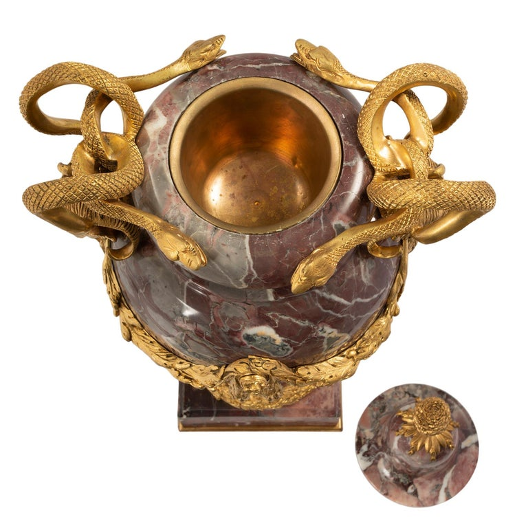 A most impressive and large scale pair of French mid-19th century Louis XVI style Brèche Violette marble and ormolu lidded urns. Each urn is raised by a thick square mottled base with a fine bottom ormolu fillet. The socle pedestals display a