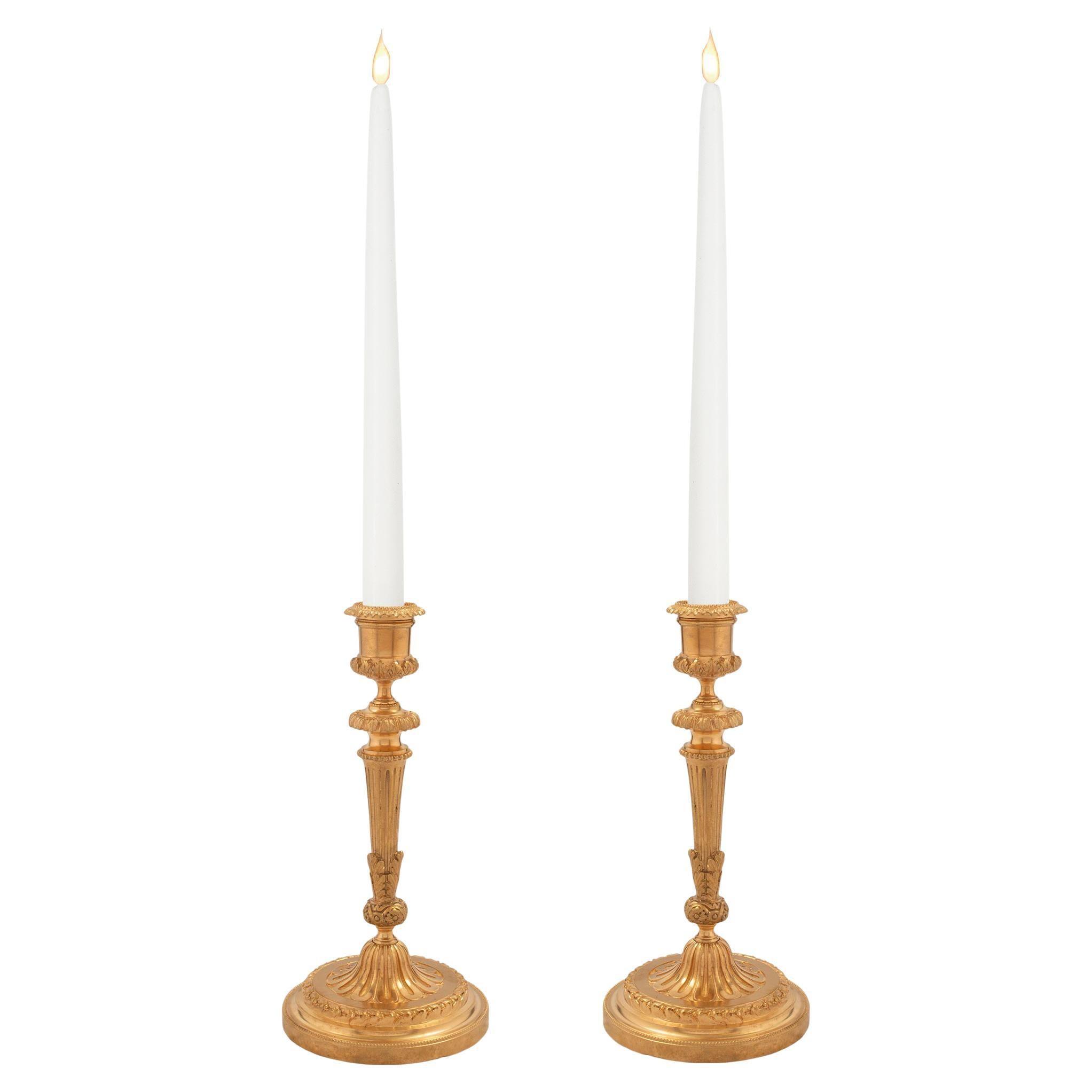 Pair of French Mid 19th Century Louis XVI St. Ormolu Candlesticks