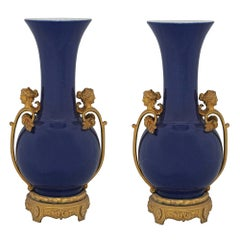Pair of French Mid-19th Century Louis XVI Style Porcelain and Ormolu Vases