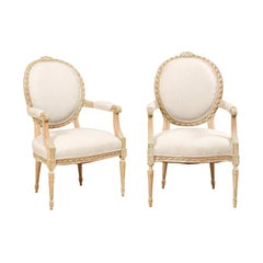 Pair of French Mid-20th Century Oval Back Armchairs with Nicely Carved Accents