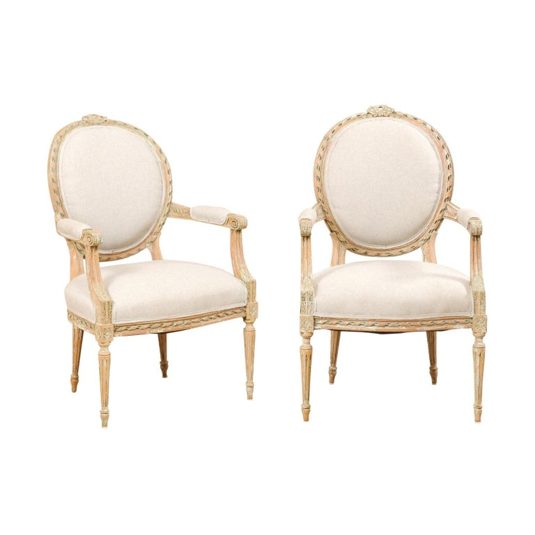 Pair of French Mid-20th Century Oval Back Armchairs with Nicely Carved Accents For Sale