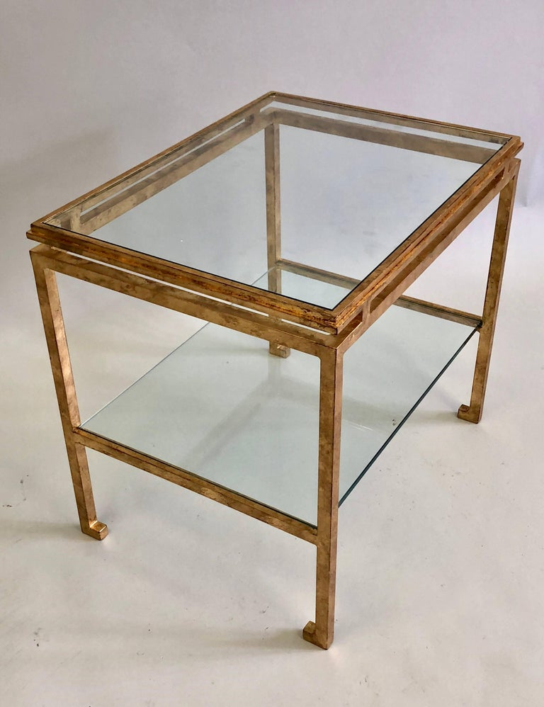 Elegant, timeless pair of French Mid-Century Modern neoclassical gilt iron side / end tables by Maison Ramsay, 1940-1960.