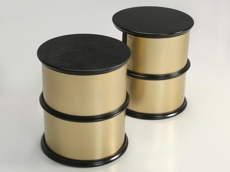 Pair of very unusual French cylinder shaped Mid-Century Modern end tables. The end tables have been ebonized the metal wrappings are cold plated bronze. The French have been fully restored. **Please note flaws in the finish, images 13, 16, 18 & 20.