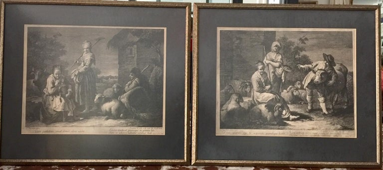 Pair of French monochromatic prints (Etchings) A beautiful pair of Prints (etchings) of a French farm yard including various farm animals such as rams, sheep and cows. Gold frames with black mats underscoring the monochromatic compositions, The