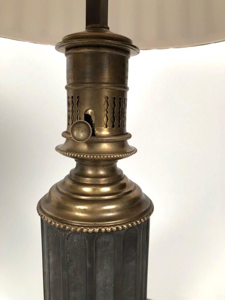 Late 19th Century Pair of French Neoclassical Brass and Steel Lamps by Neuberger, Paris For Sale