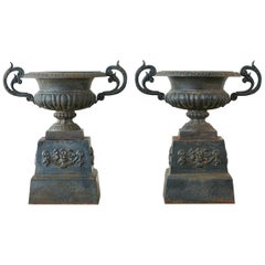 Pair of French Neoclassical Cast Iron Urns on Pedestals