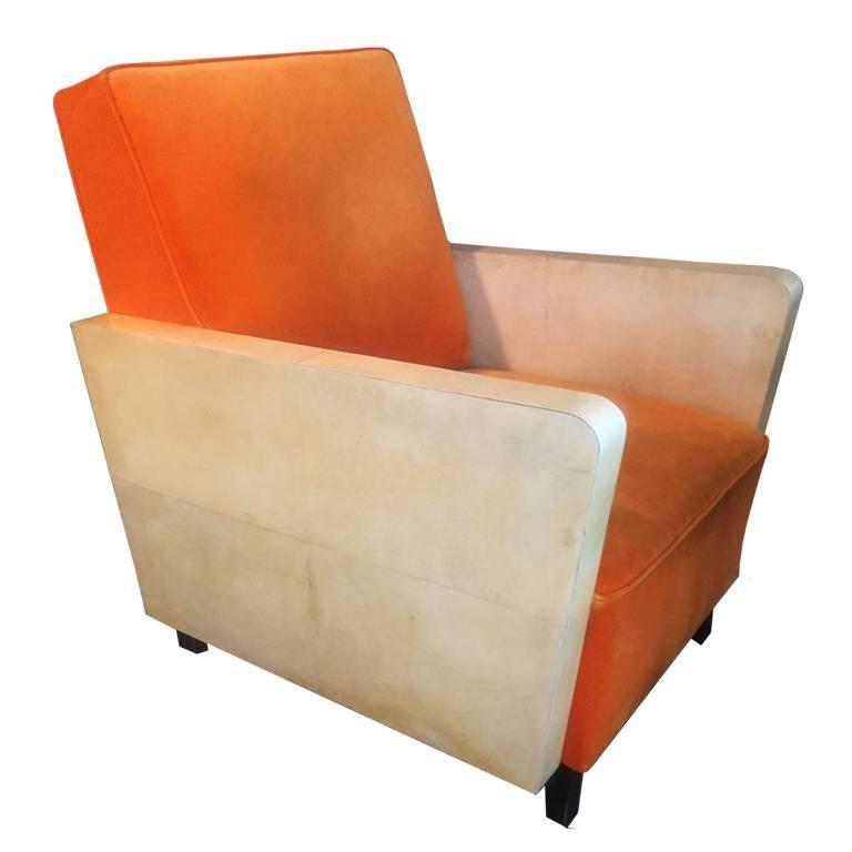 Astonishing pair of French orange armchairs in parchment, 1930.