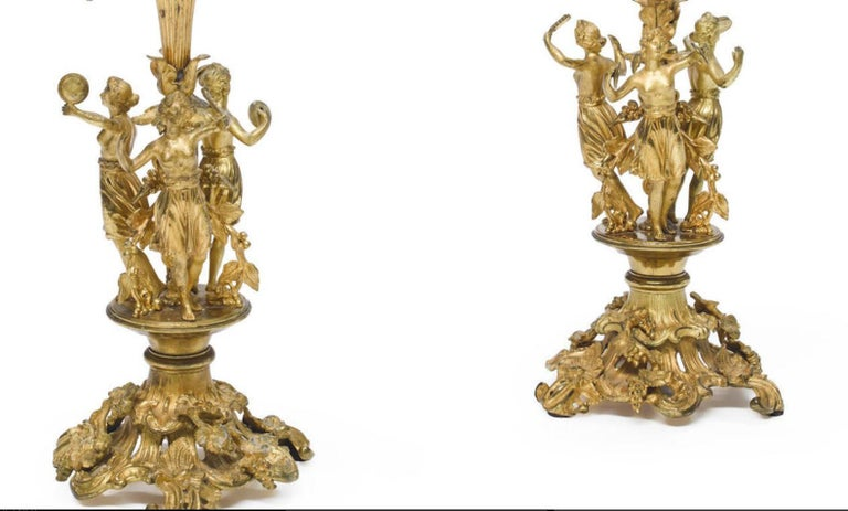 Exquisite pair of French Louis XV style gilt bronze five-light figural candelabra, 19th century. 