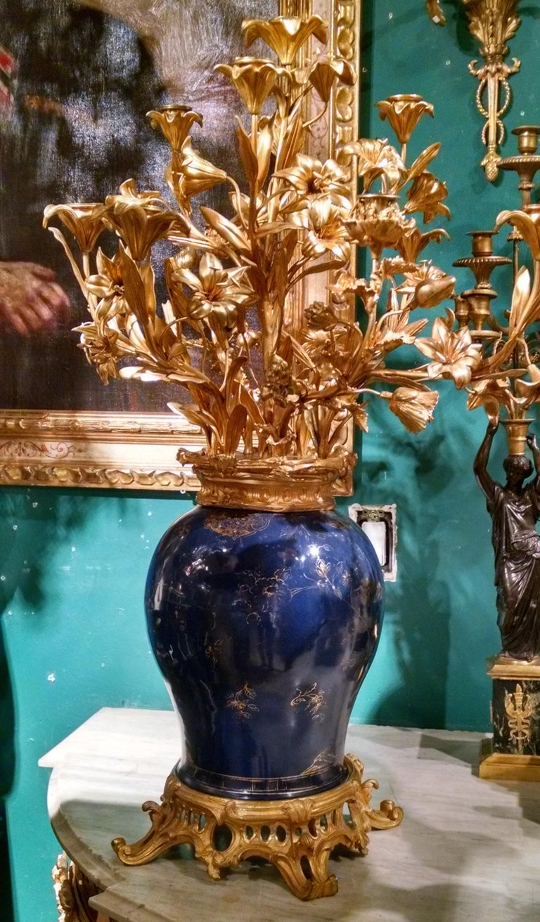 Bronze Pair of French Ormolu-Mounted Chinese Gilt and Blue-Ground Porcelain Candelabras For Sale