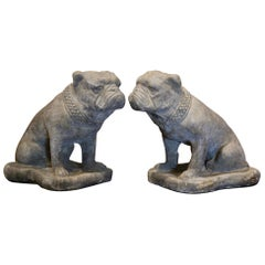 Pair of French Outdoor Weathered Carved Stone Garden Statuary Bulldogs
