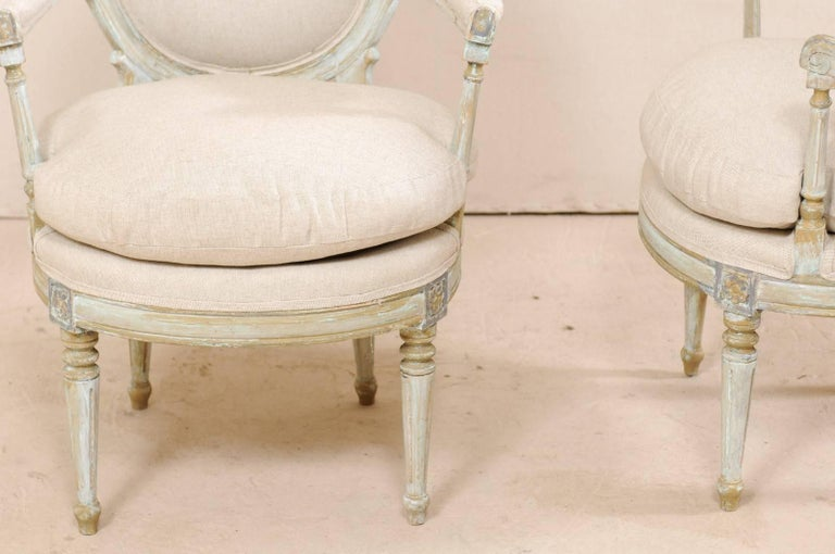 Pair of French Oval-Back Bergère Chairs with Delicately Carved Floral Motifs For Sale 3