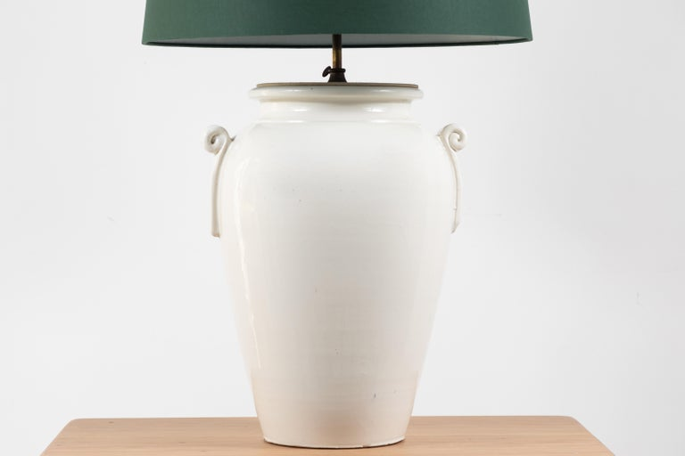 Pair of French oversized ceramic ginger jar lamps with custom green book cloth shades. The stem is adjustable.