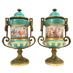 Pair of French Partial Gilt Bronze Mounted Porcelain Lidded Urns