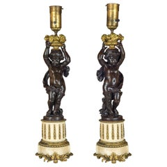 Pair of French Patinated Bronze and Gilt-Metal and Alabaster Figural Lamps