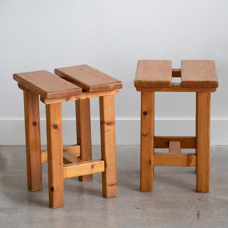 Great pair of French square stool in the style of Charlotte Perriand's Les Arc designs. Pine wood with original finish and great age and wear. Priced as a pair.