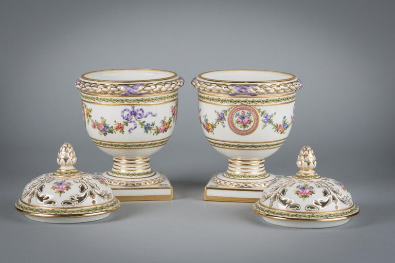Pair of French porcelain covered potpourri covered jars, circa 1890.