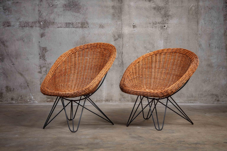 Pair of French rattan and iron barrel form chairs, 1960s  Measures: Chair 1: 32 1/2