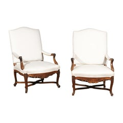 Pair of French Régence Style 19th Century Walnut Armchairs with Carved Foliage