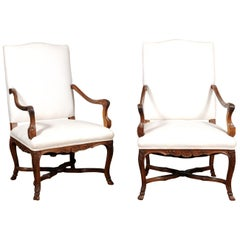 Pair of French Régence Style 19th Century Walnut Fauteuils with Carved Foliage