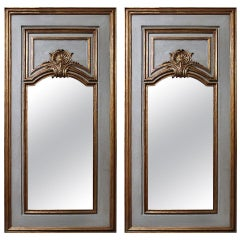 Pair of French Regence Style Mirrors in a Gray Painted and Gilt Finish